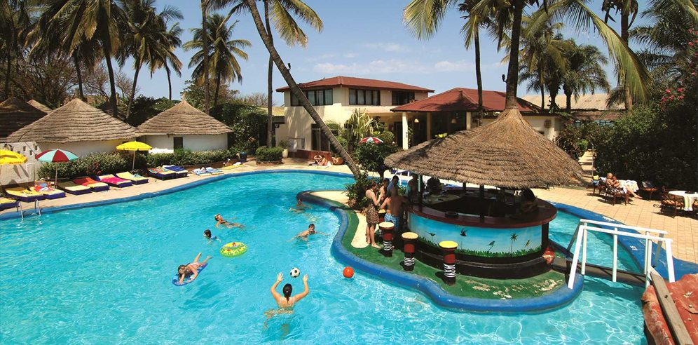 Pool with swim-up bar at African Village Hotel