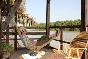 Relaxation on Waterhouse deck, Chimp Rehabilitation Project Camp