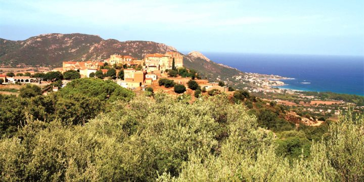 The pretty hill village of Pigna in the hills of Northern Corsica overlooking the blue waters of the Mediterranean Sea.