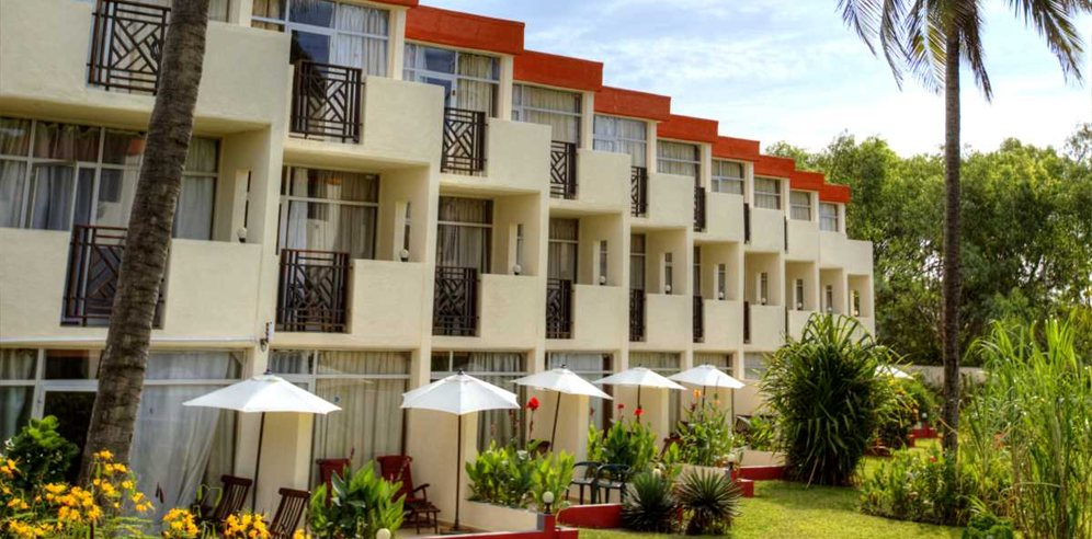 Rooms surrounded by tropical gardens at Kombo Beach Hotel