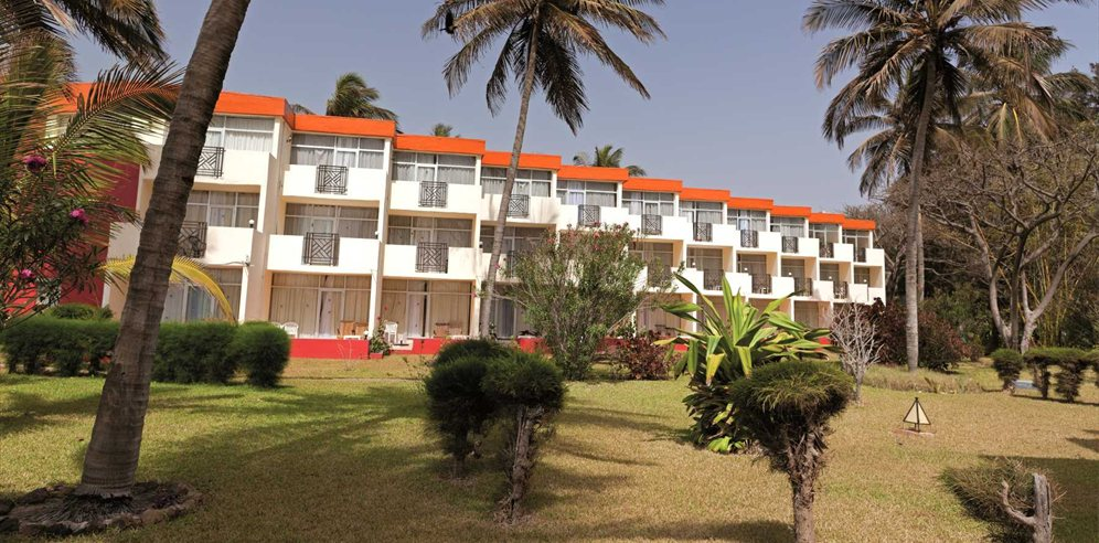 Rooms set within tropical gardens at Kombo Beach Hotel