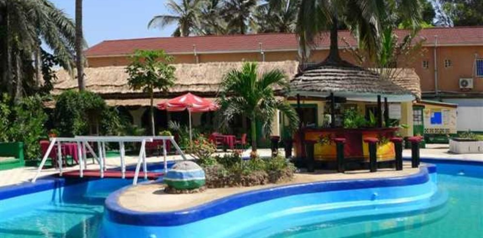 Pool with its island-based pool bar at African Village