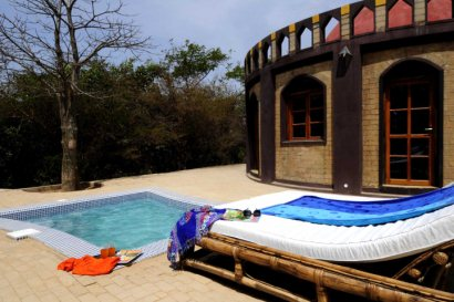 Suite with plunge pool and day bed at Sandele Eco-retreat