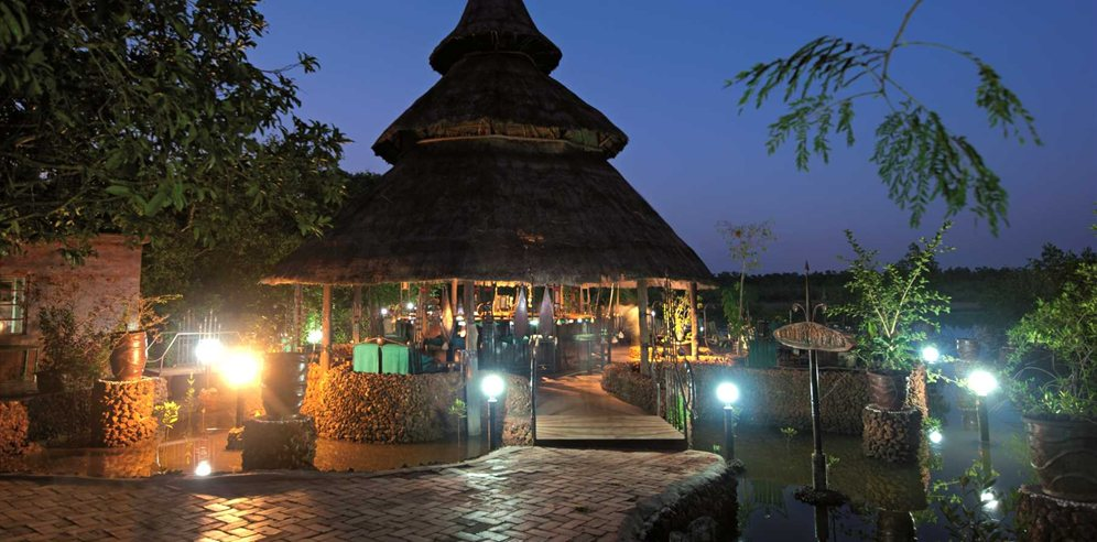 Bar area by night at Mandina Lodges