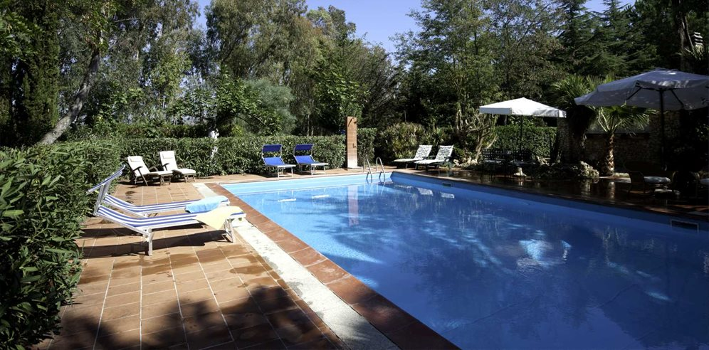 Enjoy quality time with friends and family in the large pool at Villa Santa Caterina