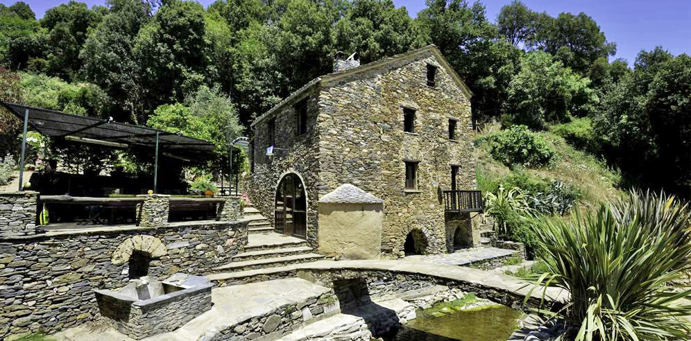 Mill and outdoor area alongside the stream
