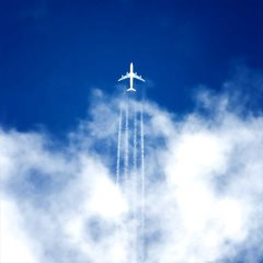 Airplane in flight through clouds