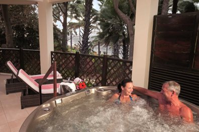 Couple in Jacuzzi at Ngala Lodge Atlantic Suite, Fajara, The Gambia