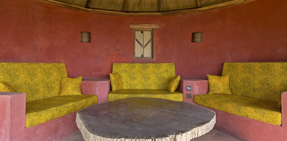 Bantaba seating area in gardens at Leo's Beach Hotel, Brufut, The Gambia