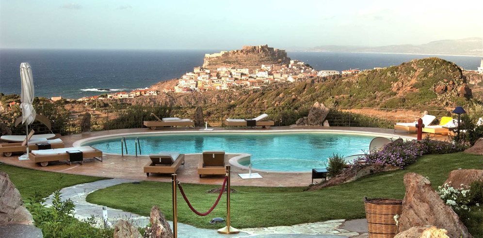 Pool Area and View over Castelsardo - Hotel Bajaloglia Resort