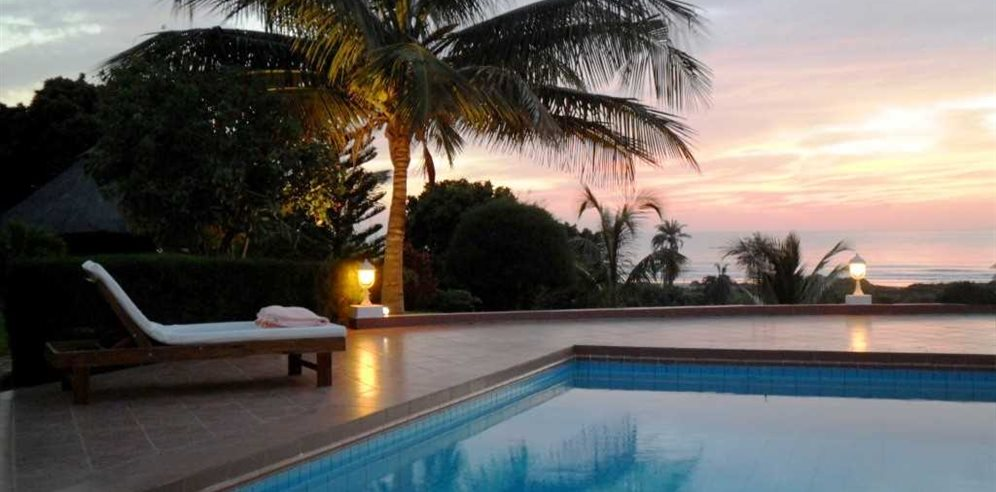 Mesmerising sunsets over the pool at White Horse Residence, Batokunku, The Gambia