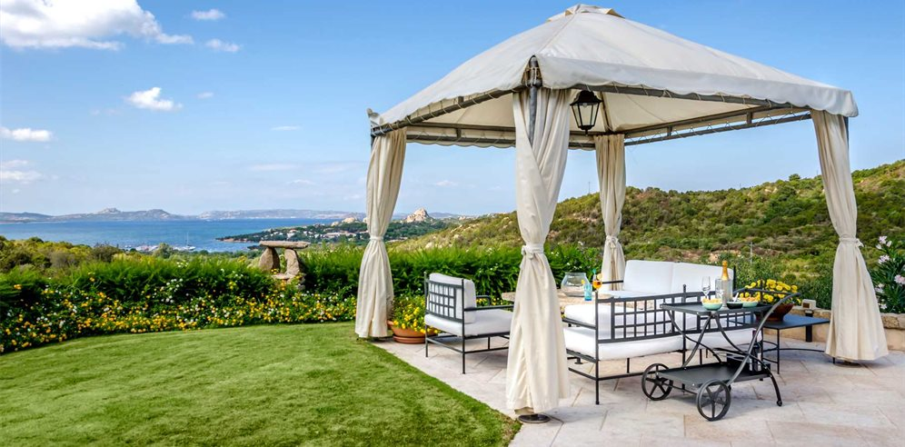 Well-maintained garden and shaded gazebo with a view at Villa Girolia