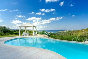 Stunning free-form swimming pool, gazebo and views of the Gulf of Cannigione at Villa Girolia