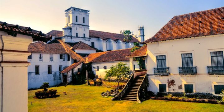 Scenic yard and old houses in historical town of Old Goa  - Michal Knitl
