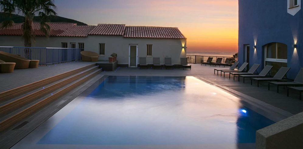 Swimming pool at sunset