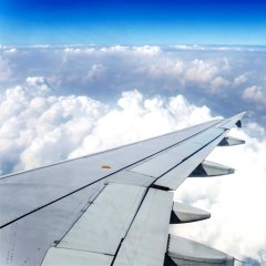 A photo out of an airplane window of the wing - Piyawat Hirunwattanasuk | Shutterstock