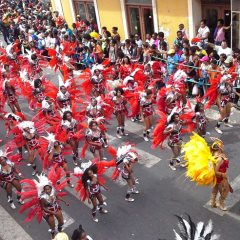 Images from Carnaval, Cape Verde's famous carnival, and customers on the carnival package tour.