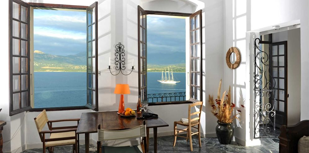 Living/dining room with sea views