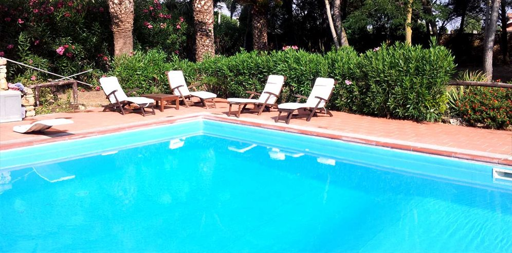 Outdoor pool area at Villas Santa Caterina