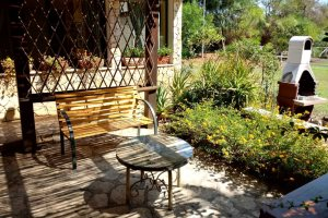 Outdoor seating in Villetta Lalinda, at Villas Santa Caterina