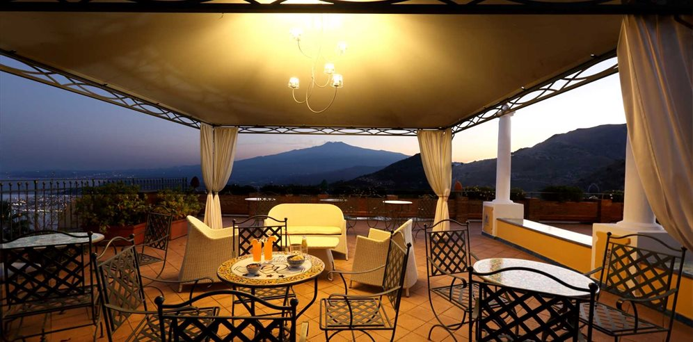 Sit and relax on the bar terrace at Villa Angela