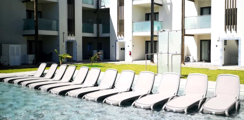 Sunloungers in the pool at Halos Casa Resort in Cape Verde