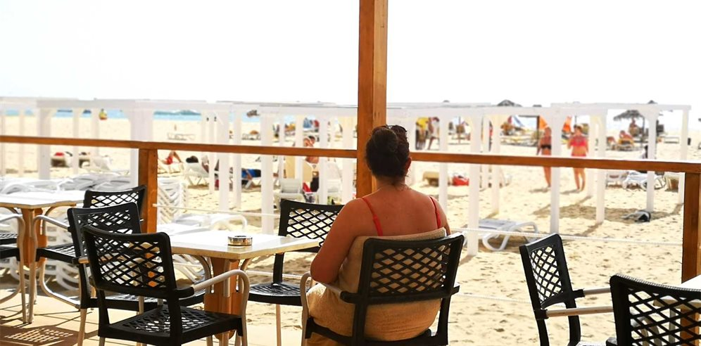 Person enjoying the view from the beach shack at Halos Casa Resort in Cape Verde