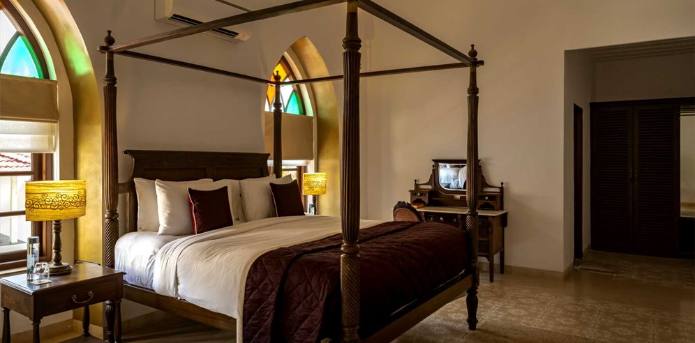 Four poster bed at The Postcard Cuelim in Goa