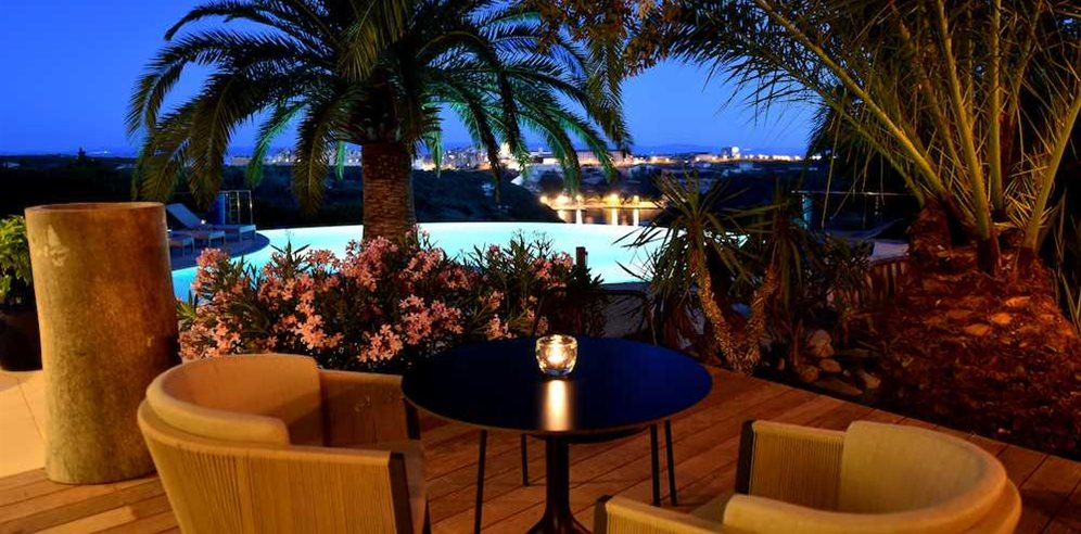 Outdoor seating area at Hotel Cala di Greco