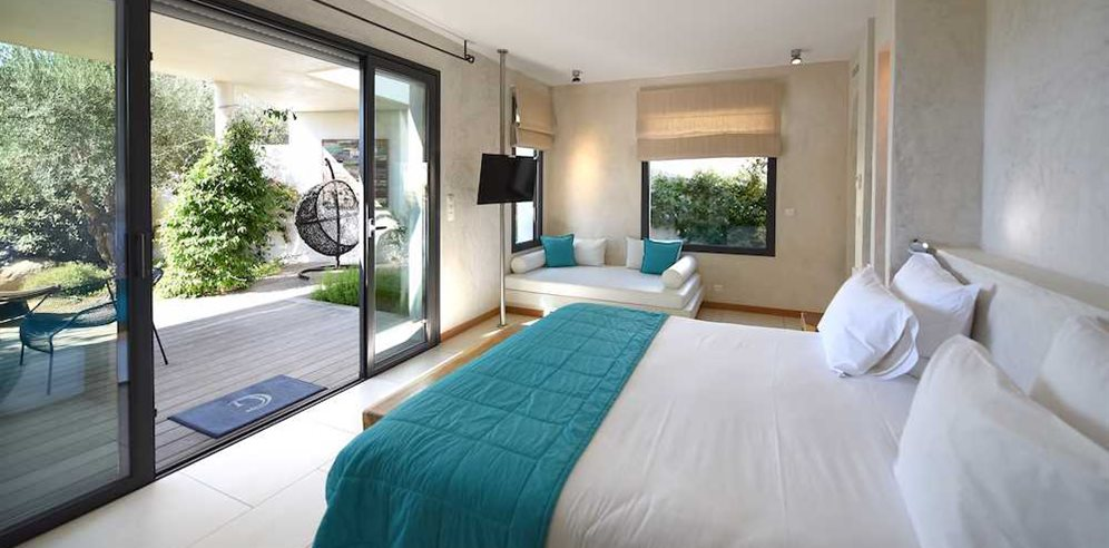 Superior Suite bedroom at Hotel Cala di Greco