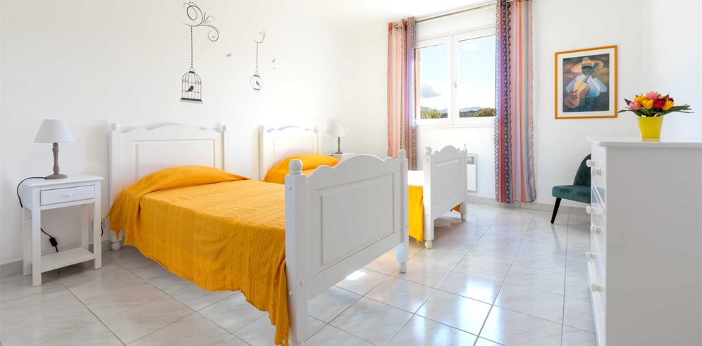 Twin bedroom at Villa Joseli